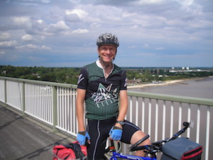 Stephen Norwood cycling on the Humber Bridge